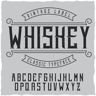 Label lettertype en voorbeeld labelontwerp met decoratie. vintage lettertype, goed te gebruiken in labels in vintage stijl van alcoholische dranken - absint, whisky, gin, rum, whisky, bourbon enz.