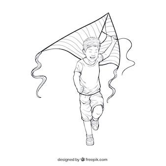 Lachende jongen speelt met zijn vlieger