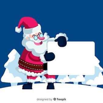 Lachende santa die leeg teken houdt