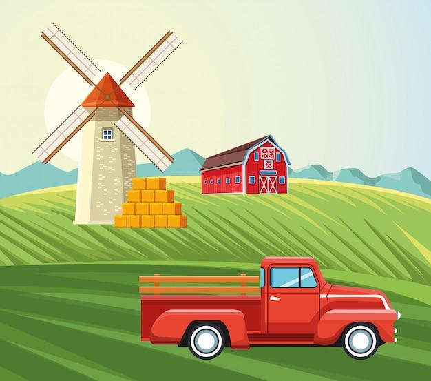 Landbouw windmolen schuur pick-up en balen hooi veld