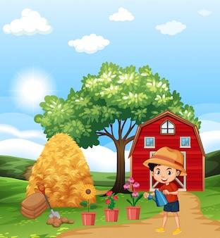 Landbouwbedrijfscène met jongen het water geven bloemen in de tuin