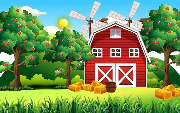 Landbouwbedrijfscène met rode schuur en windmolen