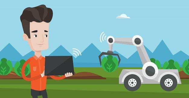 Landbouwer die het werk van robot controleert bij het gebied.