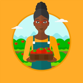 Landbouwer die tomaten vectorillustratie verzamelen.