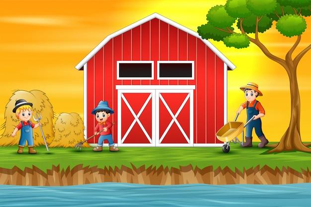 Landbouwers die voor een schuur werken