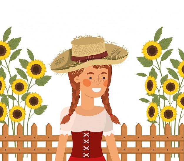 Landbouwersvrouw met strohoed en zonnebloemen