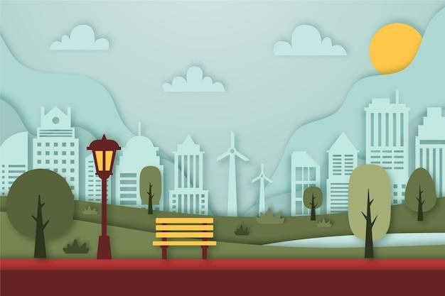 Landschap in papierstijl met gebouwen