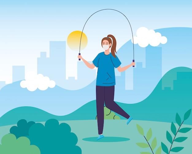 Landschap met vrouw met gezichtsmasker springen met touw
