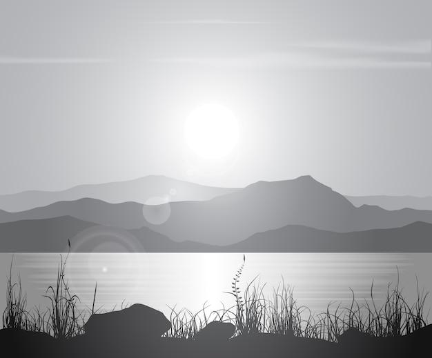 Landschap met zonsondergang aan de kust over bergketen.
