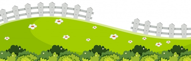 Landschapsachtergrond met groen gras en witte omheining