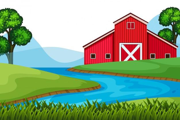 Landschapsachtergrond van rode schuur op de landbouwgrond