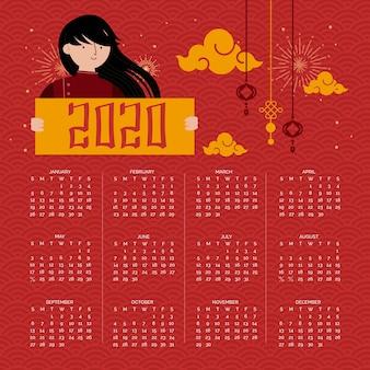 Lang zwart haarmeisje en rode chinese nieuwe jaarkalender