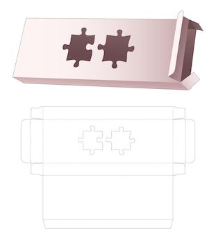 Lange eenvoudige doos met gestanste sjabloon in de vorm van een puzzel