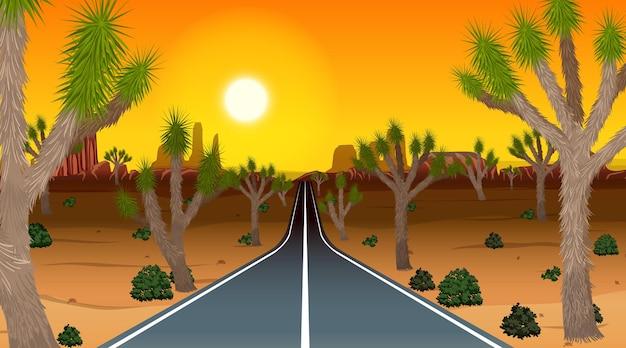 Lange weg door de woestijnlandschapsscène in zonsondergangtijd