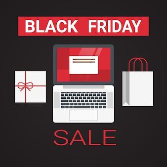 Laptop met boodschappentas en geschenkdoos voor black friday-verkoopbanner