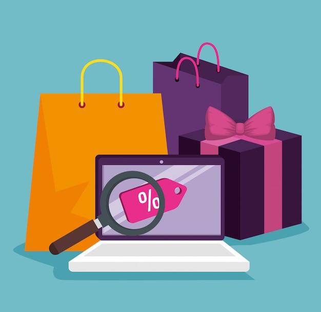 Laptop om online te winkelen met tassen