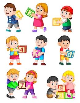 Laten we tot tien tellen met kinderen die een doos hebben