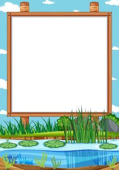 Leeg houten frame in de scène van het natuurpark met moeras