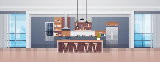 Leeg keukenbinnenland met moderne meubilairteller en toestellen