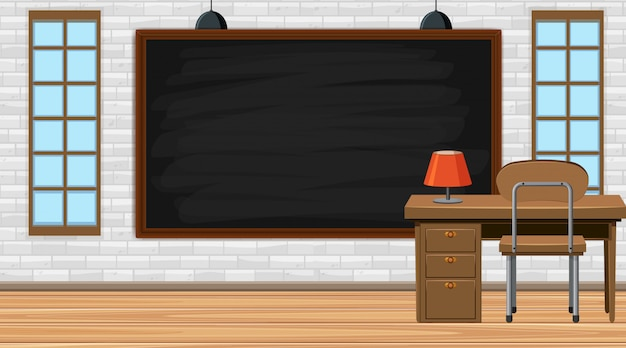 Leeg klaslokaal met bord en leraar bureau