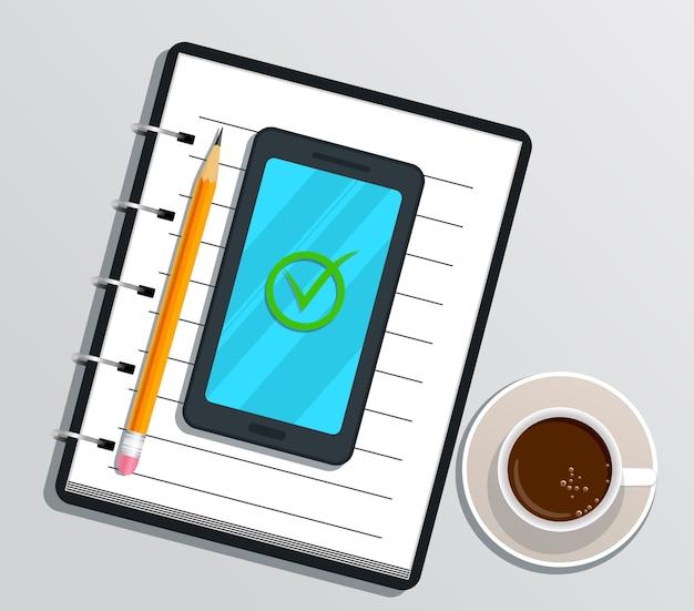 Leeg realistisch notitieboekje of blocnote met smartphone en vinkje op het scherm, potlood, kop van koffie op wit wordt geïsoleerd dat