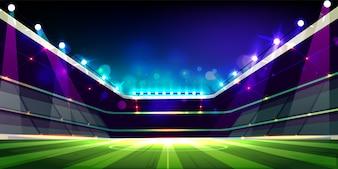Leeg voetbalgebied dat met het beeldverhaal van projectorenstlichten wordt verlicht