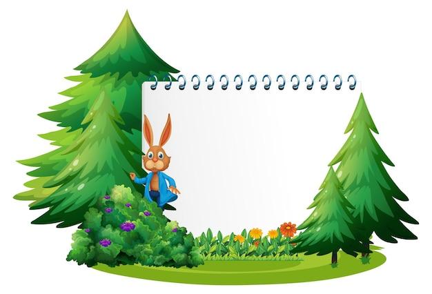 Lege banner in de tuin met een geïsoleerd konijn