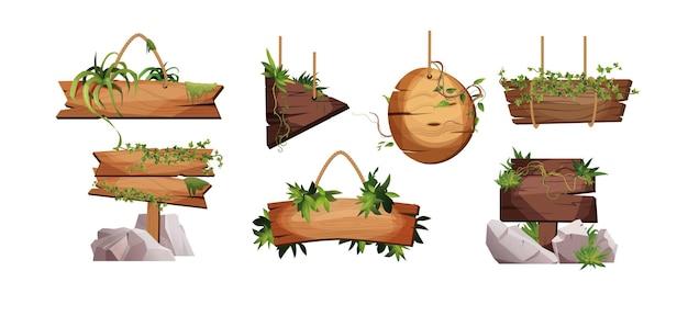 Lege houten planken hangen aan touwen met liaantakken en tropische bladeren