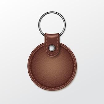 Lege lederen ronde sleutelhanger met ring voor sleutel geïsoleerd op een witte achtergrond Premium Vector