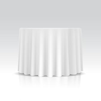 Lege ronde tafel met tafellaken