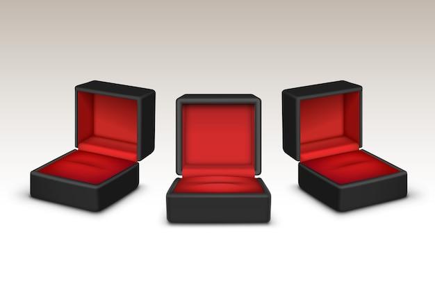 Lege rood en zwart fluweel geopend geschenkdozen sieraden