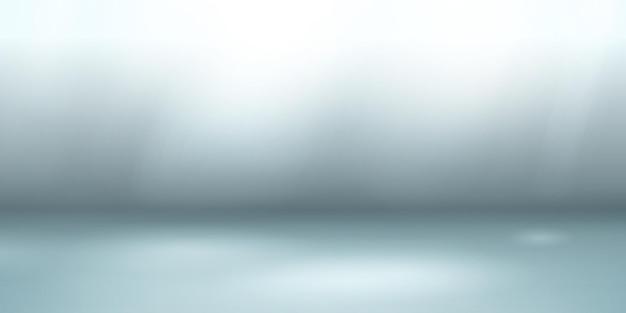 Lege studioachtergrond met zachte verlichting in lichtblauwe kleuren