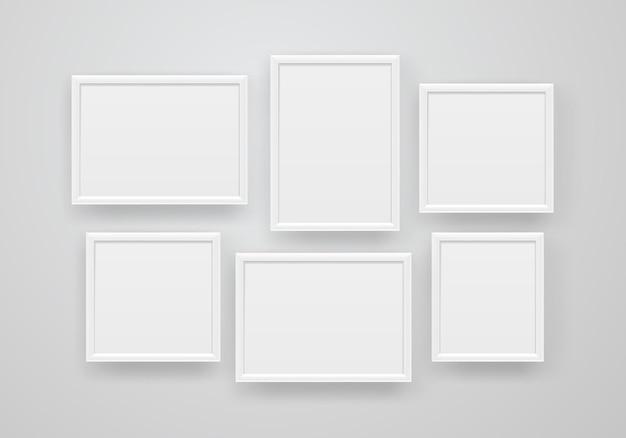 Lege witte frames op een muur