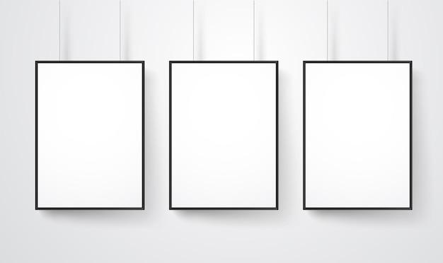 Lege witte frames op het muur vectormodel. klaar voor een inhoud