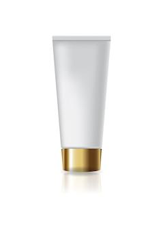 Lege witte kosmetische buis met gouden schroefdeksel.