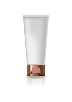 Lege witte kosmetische buis met koperdop deksel.