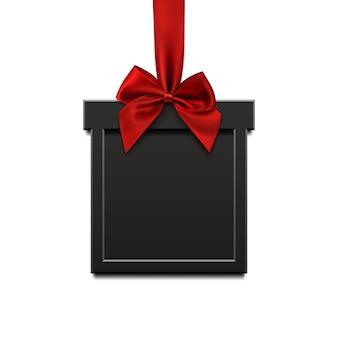Lege, zwarte, vierkante banner in de vorm van kerstcadeau met rood lint en boog, geïsoleerd op een witte achtergrond. brochure of banner sjabloon.