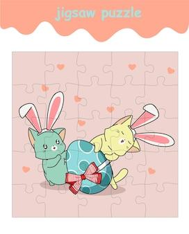 Legpuzzelspel van 2 konijnenkatten met groot ei