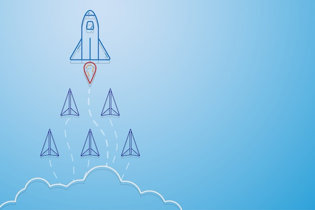 Leiderschap, teamwork en moedconcept, rocket voor leider en papieren vliegtuigen.