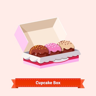 Lekker uitziende cupcakes in de kartonnen doos