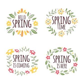 Lente belettering omgeven door bloemen frame badges