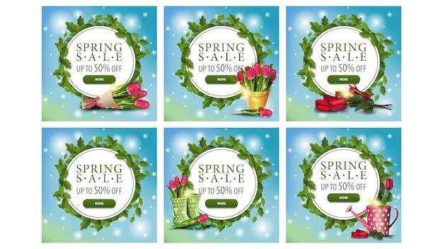Lente uitverkoop, grote set lente ronde witte kortingsbanners met een frame van wijnstokken en bladeren, knoppen en bloemen