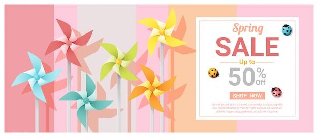 Lente verkoop banner met kleurrijke pinwheels