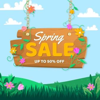 Lente verkoop met gras en bloemen