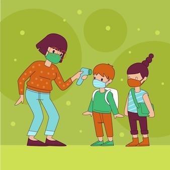 Leraar die de temperatuur van kinderen controleert