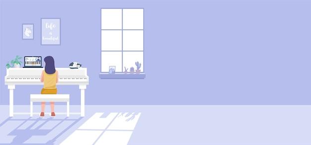 Leren op afstand vanuit huis concept, een meisje met pianolessen tijdens een videogesprek.
