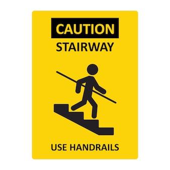 Let op trap gebruik leuningen teken. een man gaat de trap af en houdt zich vast aan de leuning. geel teken dat voor gevaar waarschuwt. vectorillustratie geïsoleerd op een witte achtergrond