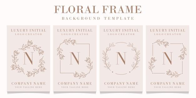 Letter n-logo met bloemenkadersjabloon