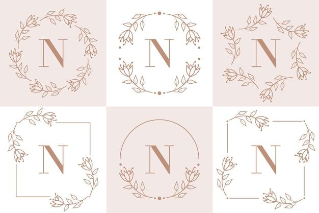 Letter n logo-ontwerp met orchidee bladelement