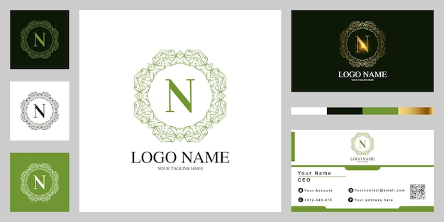 Letter n luxe sieraad bloem of mandala frame sjabloon embleemontwerp met visitekaartje.